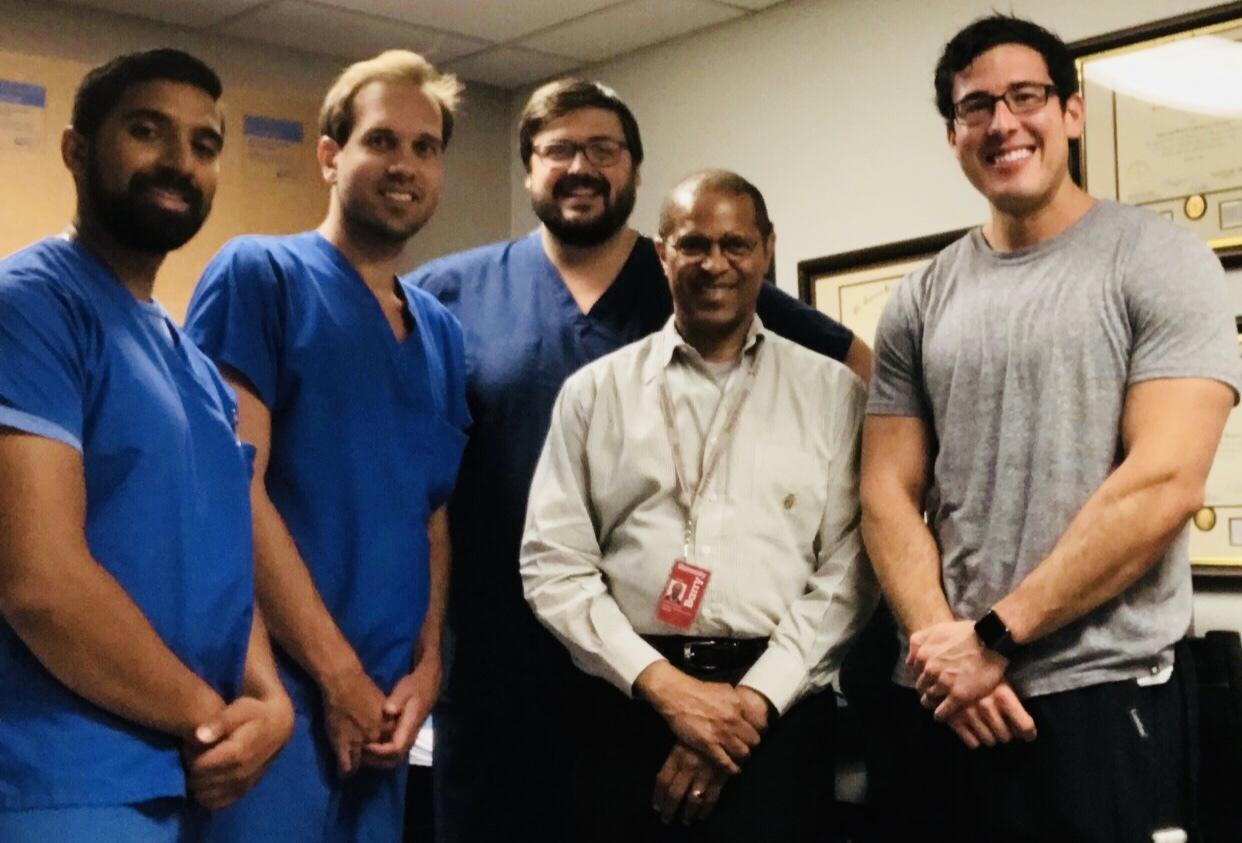 Dr. Albert Armstong, DPM, Professor of Radiology at Barry University School of Podiatric Medicine, in Miami Shores, FL, poses with a group of podiatry residents.