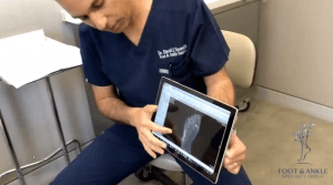 """Dr. David Soomekh, DPM, shares patients' pedCAT scans with them via a tablet. He said the datasets wirelessly upload to the viewer in less than 10 minutes."""""""